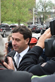 Ex-St. Louis County Executive Steve Stenger makes his way through reporters after pleading guilty to federal felonies.