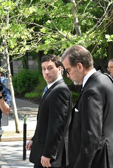 Steve Stenger (left) leaves the federal courthouse in April with his attorney, Scott Rosenblum.
