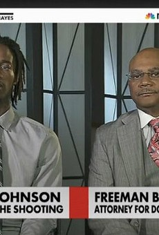 Dorian Johnson, left, during a TV appearance in 2014.