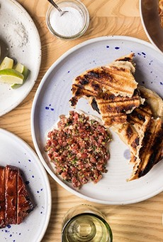 At Elmwood, a grilled pork steak (lower left) shares the menu with lamb cruda, gnochetti sardi and Wagyu beef jerky skewers.