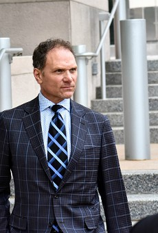 John Rallo went full power tie for his arraignment in May.