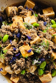 Ma po tofu is served with brown rice and quinoa.
