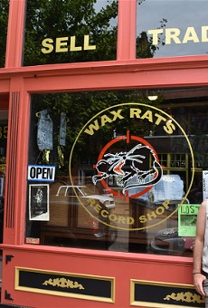 Gus Theodorow, Wax Rats' owner, in front of his Cherokee Street shop.