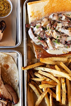 A selection of items from BEAST Butcher & Block (pictured from left to right, top to bottom): housemade spicy bratwurst, basted belly and #Beercheesesteak sandwich with fries and basted belly with fresh tortillas.