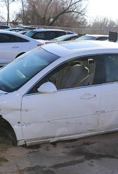 A stolen sedan was in bad shape following a collision with another stolen vehicle.