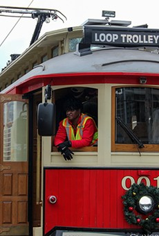 A worker on a packed Delmar Trolley on Sunday.