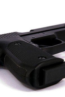 A ten-year-old found a stolen gun outside his house and accidentally shot himself, police say.