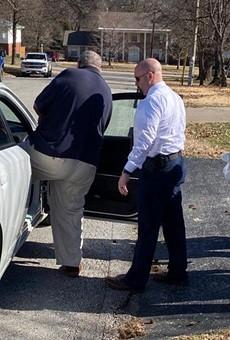 Retired priest Frederick Lutz is taken into custody on Wednesday, February 19.