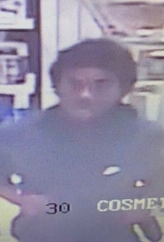 """St. Louis County police say they're looking for this """"person of interest"""" in the shooting."""