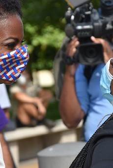 St. Louis Treasurer Tishaura Jones greets Cori Bush in August after their primary wins.
