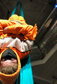 One student, donning a clownfish costume, performs in aerial silks before he becomes a sushi roll for his family's sushi recipe.