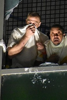 Inmates appear to react to a chemical irritant at the St. Louis City Justice Center