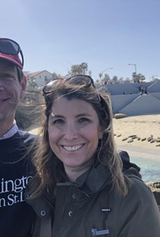 Jeffrey Davis and his wife, Tasha, watch harbor seals on a beach in San Diego.