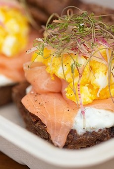 Janie's Mill rye biscuits with house-cured salmon, creme fraiche, dill micros and sieved egg.