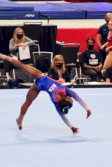 Simone Biles, the most highly decorated American gymnast, completes her floor routine at Friday's Olympic trials.