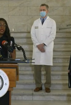 Mayor Tishaura Jones (left), Dr. Clay Dunagan (middle), and St. Louis County Executive Sam Page (right) answer questions at a press conference about the reinstated mask mandate.