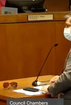 Dr. Faisal Khan speaks to the St. Louis County Council on July 28.