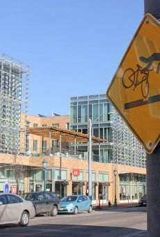 Signs warn cyclists of the dangers posed by the Loop trolley.