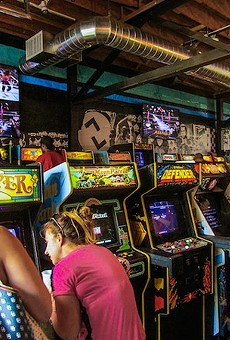 Customers enjoy Minneapolis' Up-Down Arcade Bar.