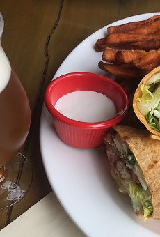 Third Wheel Brewing's chicken wrap with sweet potato fries.