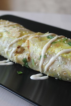 """A """"bing"""" stuffed with ham, cucumber, egg, tomato and lettuce."""
