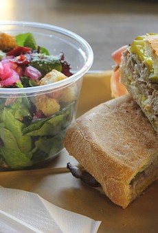 """The """"Cubano"""" sandwich with a side salad is among seven sandwich offerings on the current menu."""