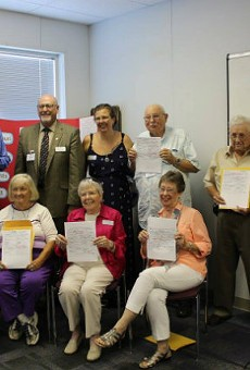 Eight pre-1941 adoptees were able to receive their birth certificates in August 2016 thanks to a new Missouri law. State Rep. Don Phillips is in the back.