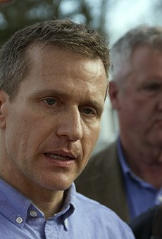 Governor Eric Greitens allowed a bill to become law that would take away the city's minimum wage increase.