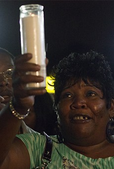 Annie Smith at a candlelight vigil for her son Monday night.