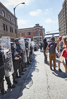 Protesters face off in downtown St. Louis yesterday after the acquittal of a former city cop.