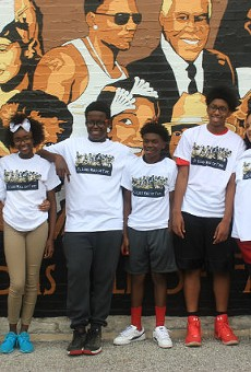 The kids from the Boys and Girls Club pose with the new St. Louis Wall of Fame they created.