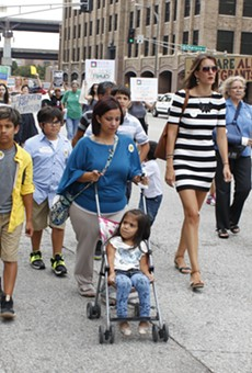 Carlene Garcia marches down Tucker Blvd. with supporters to the Thomas F. Eagleton Courthouse.