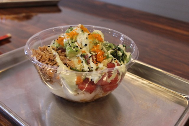A medium-sized tuna bowl topped with avocado, fried onions, wasabi sauce and roe. - SARAH FENSKE