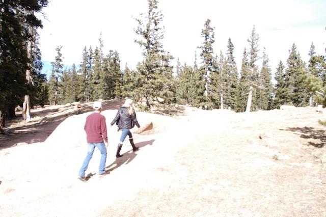 Sarah and Zachary Plank make their way up the mountain. - JESSICA MACHETTA/COLORADOPOLITICS.COM
