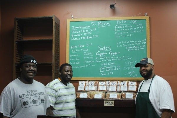 Edward McFarlane (left) with Dixon Smoke Company co-owners Aaron McFarland and Joe Dixon. - SARAH FENSKE