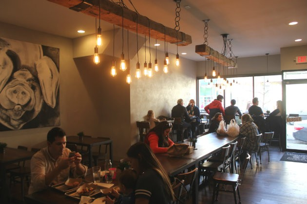 The bustling dining room at Frankly on Cherokee. - CHERYL BAEHR