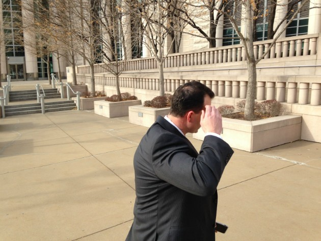 William Cafarella dodges the camera in December 2016 as he leaves federal court. - PHOTO BY DOYLE MURPHY
