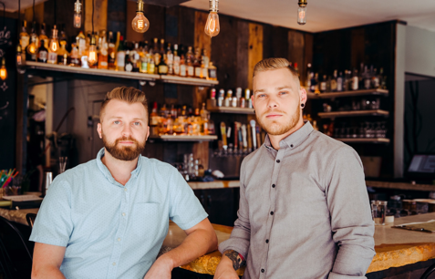 Travis Howard and Tim Wiggins of Retreat Gastropub and Yellowbelly. - PHOTO COURTESY OF ANDREW TRINH PHOTOGRAPHY.