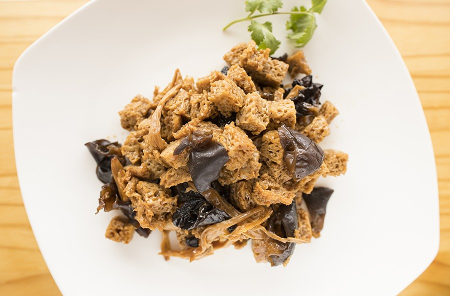 Another prepared offering: braised wheat gluten with mushrooms. - MABEL SUEN