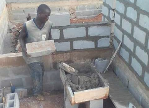 Mary's son, Peter, at work in the Ivory Coast. - COURTESY OF TUGBAH FAMILY
