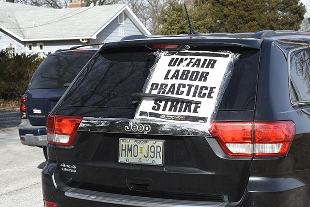 "A car parked outside of Christian Care home with a sign that reads, ""unfair labor practice strike"". - MEGAN ANTHONY"