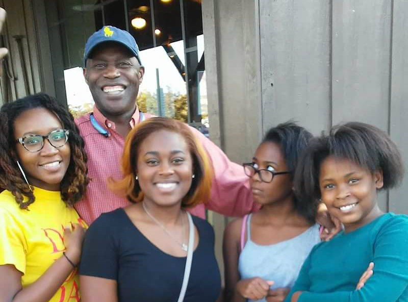 Charles Lewis with his granddaughters. Lewis is now suing the city. - COURTESY OF CHARLES LEWIS