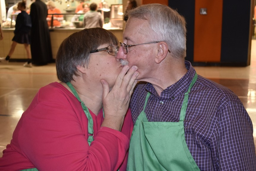 Leslie and Chuck Polokonis share a Valentine's Day kiss at St. Francis of Assisi Church. - ALLISON BABKA