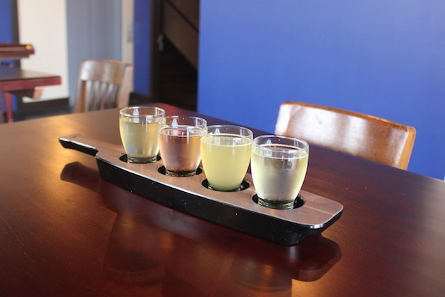 A flight of all four of Brick River's current line of cider. - SARAH FENSKE