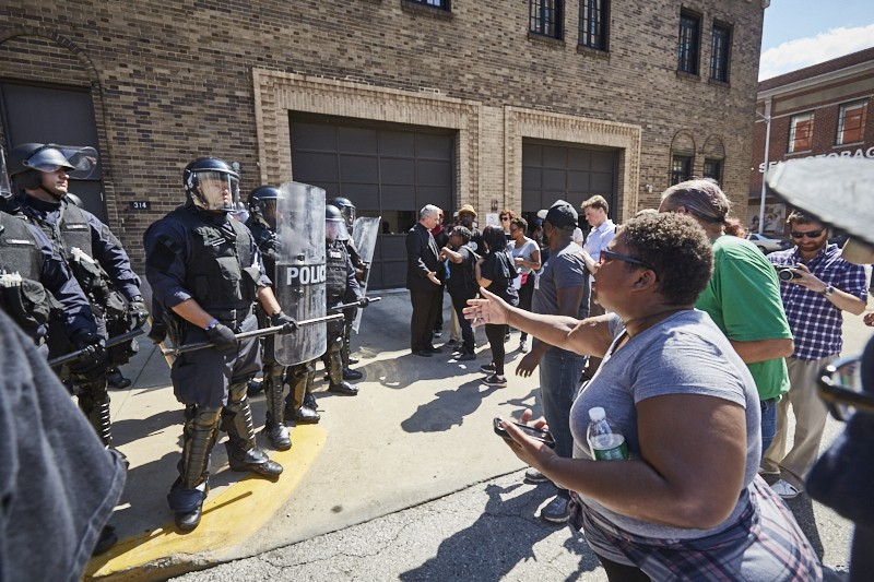 St. Louis Police face off with protesters. Wouldn't this look better with bubble wands? - THEO WELLING
