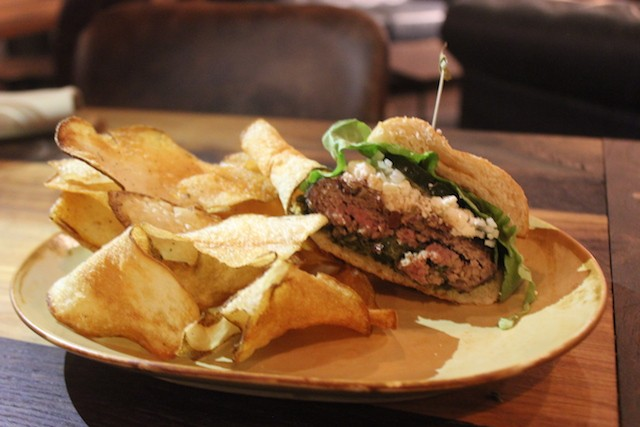 The lamb burger comes on a creamy spinach base and is topped with feta. - SARAH FENSKE