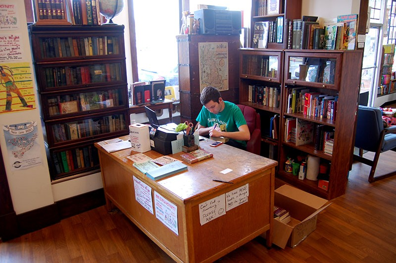 Mark Gould works the front desk at the Book House. - HARLAN MCCARTHY