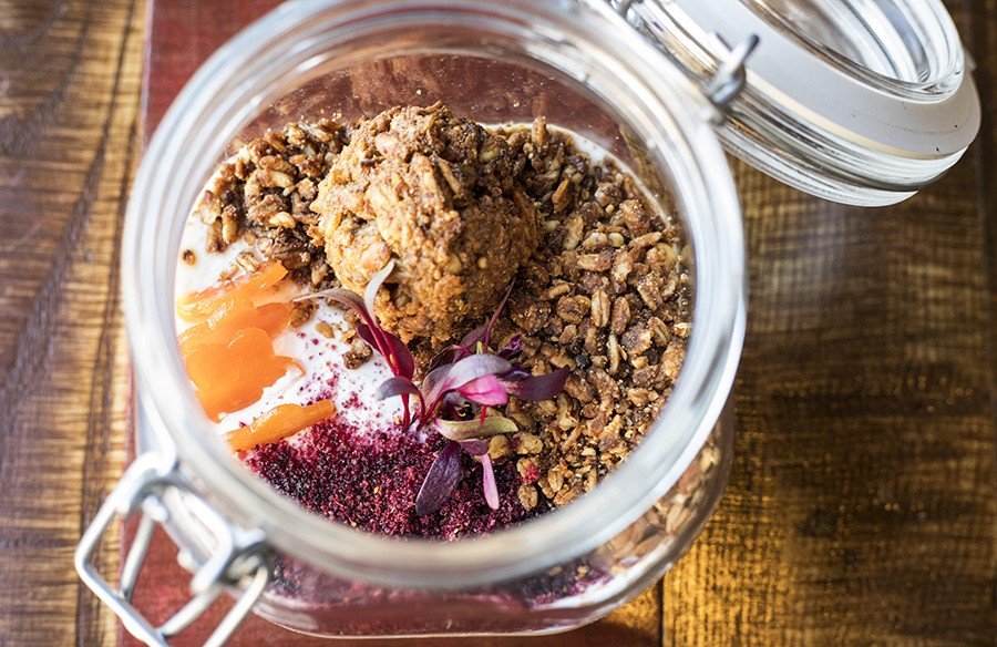 Housemade yogurt with dried apricots, granola, huckleberry powder, carrot cookie and pawpaw-apricot puree. - MABEL SUEN