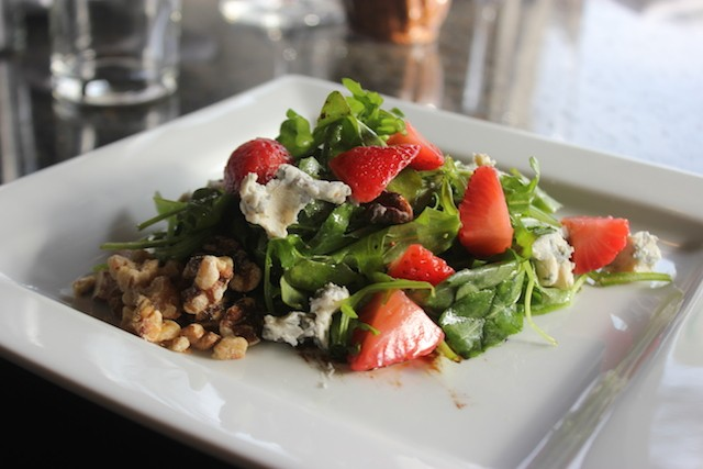 The strawberry and Champagne salad is studded with red onion and gorgonzola. - SARAH FENSKE