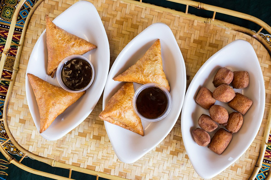 Sumbusas and mandazi, or African doughnuts, show the kitchen's skill around a fryer. - MABEL SUEN